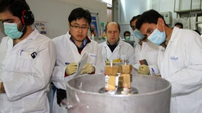 IAEA safeguard inspectors (middle left and far right) with their Iranian counterparts at the Natanz Fuel Enrichment Plant in 2014. New high-tech devices, such as online uranium enrichment monitors, could help to continuously monitor Iran's activities around the clock. Photo courtesy of V. Fournier/IAEA.