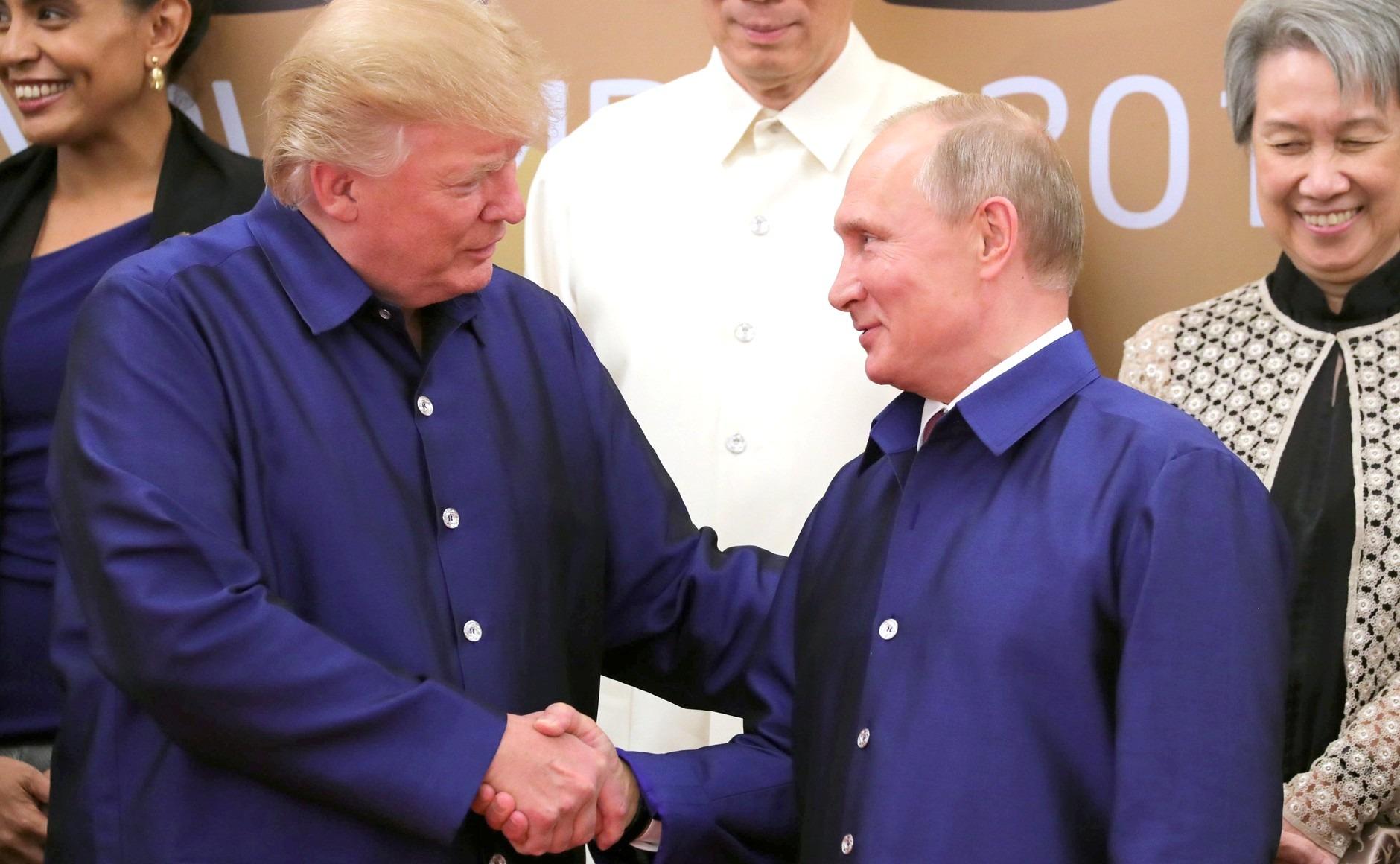 Putin and Trump shake hands at APEC meeting in Vietnam in November 2017