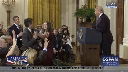 A White House intern tries to take CNN reporter Jim Acosta's microphone