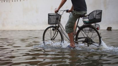 biking through floodwaters