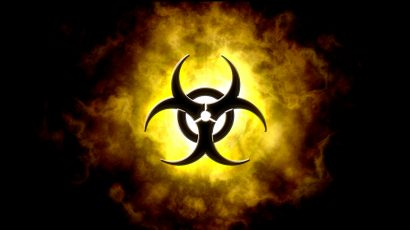 A black biohazard symbol against a yellow and black smoke-like background.