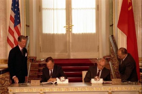George H.W. Bush and Mikhail Gorbachev sign the Strategic Arms Reduction Treaty (START) in 1991.